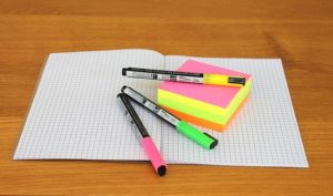 notebook and highlighters