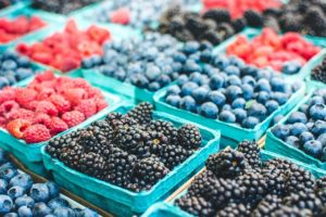 berries at a farmers market stand